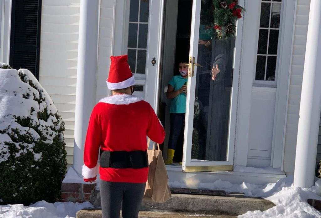 Ana went the extra mile this holiday season, playing Santa and delivering gifts to girls.